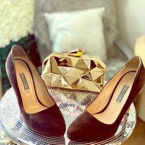 Dark brown Prada pumps with gold heel